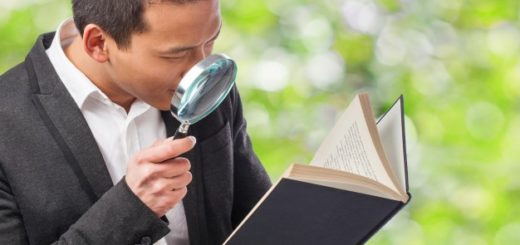 detective-reading-a-book-with-a-magnifying-glass_1149-137